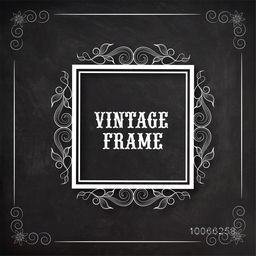 Beautiful floral design decorated square vintage frame on blackboard background with space for your wishes.
