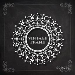 Creative stylish floral design decorated rounded vintage frame on blackboard background.