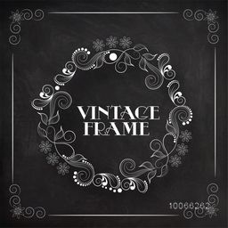 Beautiful floral design decorated rounded Vintage frame created by white chalk on blackboard background.