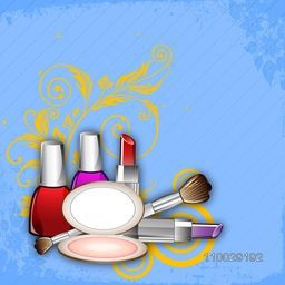 Makeup cosmetics on floral decorated blue background.
