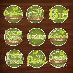 Green Stickers of Pure Organic Products, 100% Natural Farm Fresh Labels, Premium Quality Bio Products Tags and Ribbons, Set of creative lettering design on wooden background, Food and Drink concept.