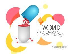World Health Day concept with red glossy hearts coming out from a capsule pill on colorful abstract background.