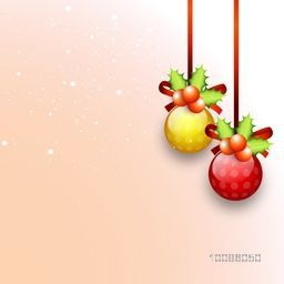 Glossy hanging Xmas Balls with Mistletoes hanging on shiny background for Merry Christmas celebration.