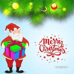 Santa Claus holding big gift box on fir branches decorated background for Merry Christmas celebration.