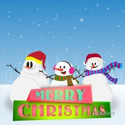 Cute Smiling Snowmen on snowy background for Merry Christmas celebration.