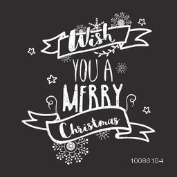 Hand drawn lettering design on chalkboard background for Merry Christmas celebration.