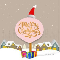 Winter background with snow covered houses and colorful gifts for Merry Christmas celebration.