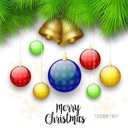 Elegant greeting card decorated with golden jingle bells and colorful xmas balls for Merry Christmas celebration.