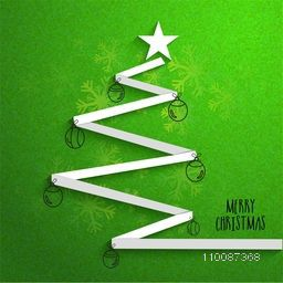 Creative Christmas Tree design made by white ribbon with balls and star decoration on grungy green background.
