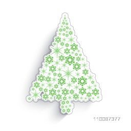 Paper cut out design of Christmas Tree with snowflakes decoration, Can be used as sticker, tag or label.