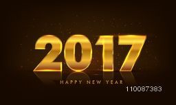 Glowing Golden Text 2017 on glossy background for Happy New Year celebration.