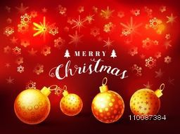 Beautiful glowing background decorated with glossy Xmas Balls and Snowflakes for Merry Christmas celebration.