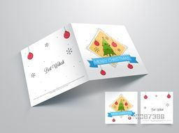 Elegant Greeting Card design with Xmas Tree and Balls decoration for Merry Christmas celebration.