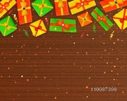 Holiday celebration wooden background with colorful gift boxes and presents.