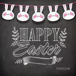 Elegant greeting card design decorated with stylish text Happy Easter, blank ribbon and cute hanging bunnies on chalkboard background.