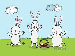 Cute rabbits with eggs in a basket on nature background for Happy Easter celebration.