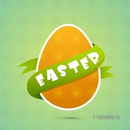 Orange floral decorated egg covered by green ribbon for Happy Easter celebration.