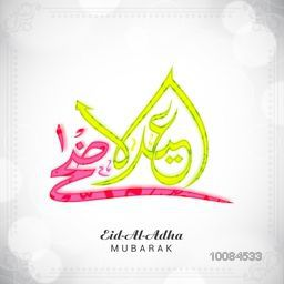 Colorful Arabic Islamic Calligraphy Text Eid-Al-Adha on shiny background, Vector greeting card design for Muslim Community, Festival of Sacrifice Celebration.