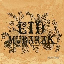 Vintage greeting card design with floral decorated text Eid Mubarak on grungy brown background.