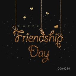 Golden Glittering Text Happy Friendship Day hanging on black background.
