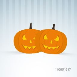 Two scary pumpkin faces in orange colour on linen background.