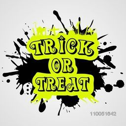 Stylish text Trick Or Treat with black stain on grey background.