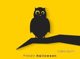 Silhouette of a dangerous owl sitting on a dry branch with stylish text for Halloween on bright yellow background.