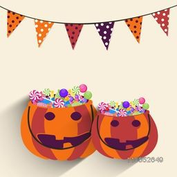 Pumpkin basket full of lollipops and bunting on beige background for Halloween party celebration.