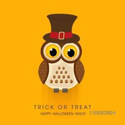 Halloween night poster with scary owl wearing magician hat and stylish Trick Or Treat text on orange background.