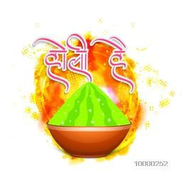 Green colour powder (Gulaal) in glossy pot and Hindi text Holi Hai (Its Holi) on beautiful creative background for Indian Festival of Colours celebration.