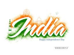 Creative white text India with saffron, green splash and famous Indian Monuments for Independence Day and Republic Day celebration.