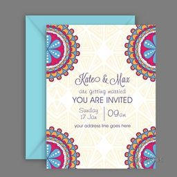 Colorful floral design decorated beautiful Wedding Invitation Card with envelope.