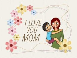 Cute little boy playing in his mother's lap and saying I Love You Mom on occasion of Happy Mother's Day celebration.