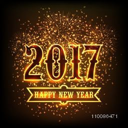Creative glowing text 2017 on sparkling fireworks background, Elegant greeting card design for Happy New Year celebration.