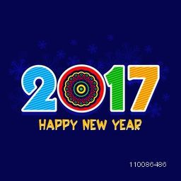 Greeting Card design with creative colorful text 2017 on snowflakes decorated blue background for Happy New Year celebration.
