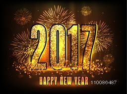 Golden glittering text 2017 on fireworks background , Elegant greeting card design for Happy New Year celebration.