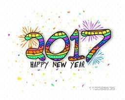 Creative colorful text 2017 on fireworks background for Happy New Year celebration.