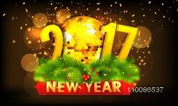 3D golden text 2017 with Disco Ball and fir branches, Glowing festive holiday background. Elegant poster, banner or flyer for Happy New Year celebration.