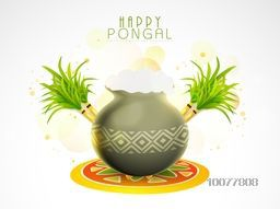 Creative glossy mud pot, full of rice with sugarcanes on rangoli for South Indian harvesting festival, Happy Pongal celebration.