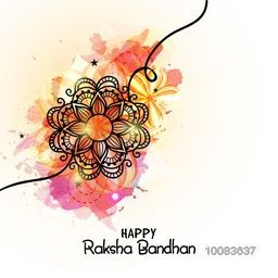 Beautiful Glowing Rakhi made by floral design on colourful abstract background for Happy Raksha Bandhan celebration concept.