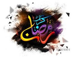 Colourful glossy Arabic Islamic Calligraphy text Ramadan Kareem on creative abstract background for Holy Month of Muslim Community celebration.