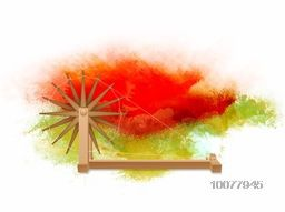 Happy Indian Republic Day celebration with Spinning Wheel on saffron and green colours splash background.