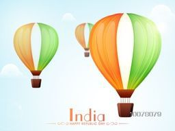 Glossy National Flag colours hot air balloons flying in sky for Happy Indian Republic Day celebration.