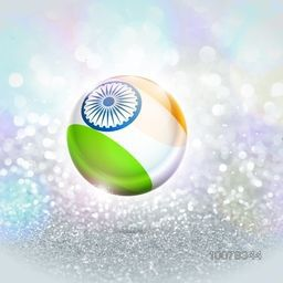Creative glossy Ball painted in National Flag colours with Ashoka Wheel on silver glitter background for Indian Republic Day celebration.