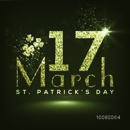 Creative glittering text 17 March with shamrock leaves on green background for Happy St. Patrick's Day celebration.