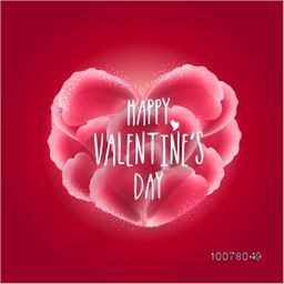 Beautiful creative heart made by pink flower petals on red background for Happy Valentine's Day celebration.