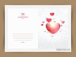 Elegant greeting card with glossy heart on silver glitter background for Happy Valentine's Day celebration.