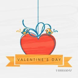 Cute romantic love bird sitting on red hanging heart with text on ribbon for Happy Valentine's Day celebration.