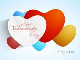 Colorful romantic love hearts with text Happy Valentine's Day on shiny sky blue background.