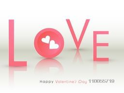 Pink text Love with hearts on glossy grey background for Happy Valentine's Day celebrations.